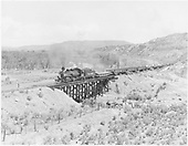 D&amp;RGW #478 with pipe train on Farmington Branch trestle near Inca.<br /> D&amp;RGW  Inca, NM  Taken by Payne, Andy M. - 6/3/1968