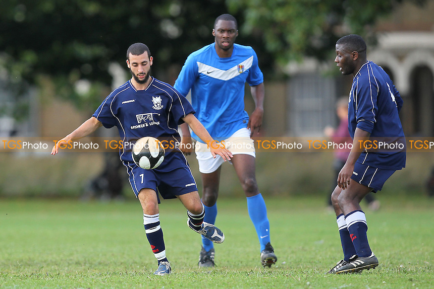FC Barltett (blue/white) vs Phoenix (dark blue) - Hackney & Leyton Sunday League Football at Victoria Park, London - 08/09/13 - MANDATORY CREDIT: Gavin Ellis/TGSPHOTO - Self billing applies where appropriate - 0845 094 6026 - contact@tgsphoto.co.uk - NO UNPAID USE