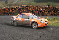 Jock Armstrong / Kirsty Riddick at Junction 9 on Craignell, Special Stage 1 of the Ian Broll Merrick Stages Rally 2012, Round 7 of the RAC MSA Scotish Rally Championship which was organised by Machars Car Club and Scottish Sporting Car Club and based in Wigtown on 1.9.12.