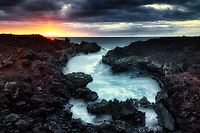 Inlet and palm trees with sunset. The Kohaka Coast, Hawaii, The Big Island
