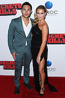 "LOS ANGELES, CA - OCTOBER 02: Alexa Vega and her fiance Carlos Pena, Jr arrive at the Premiere Of Open Road Films' ""Machete Kills"" held at Regal Cinemas L.A. Live on October 2, 2013 in Los Angeles, California. (Photo by Xavier Collin/Celebrity Monitor)"