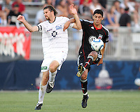 Pablo Hernandez #21 of D.C. United tangles with Dustin Bixler #3 of the Harrisburg City Islanders during a US Open Cup match at the Maryland Soccerplex on July 21 2010, in Boyds, Maryland. United won 2-0.