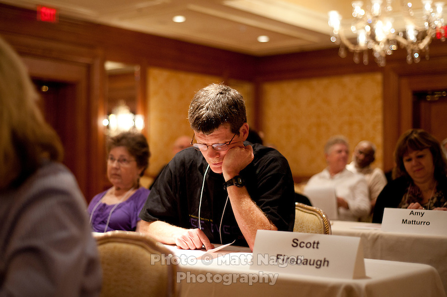 Scott Firebaugh (cq), from Knoxville, Tennessee, double checks his words near the end of the written portion of the AARP National Spelling Bee for people aged 50 years and older at the Little America Hotel in Cheyenne, Wyoming, Saturday, June 18, 2011. ..Photo by Matt Nager