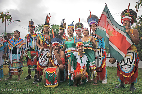 Amerindians - the Smoke ceremony in Arima, Trinidad - group from Suriname pose for a group photo in their colourful national dress