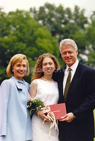 United States President Bill Clinton, right, and first lady Hillary Rodham Clinton, left, attend Chelsea Clinton's high school graduation on June 6, 1997 at the Sidwell Friends School in Washington, D.C.  Following her graduation Chelsea Clinton attended Stanford University.<br /> Mandatory Credit: Sharon Farmer / White House via CNP/MediaPunch