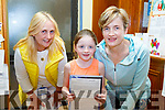 Athea and District Credit Union's Eilish Geoghegan helping Eimear and Mary Hunt at the Credit Office on Thursday night