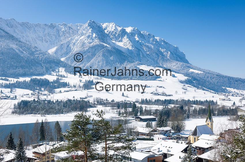 Austria, Tyrol, Kaiserwinkl, winter scene - village and lake Walchsee and Zahmer Kaiser mountains   Oesterreich, Tirol, Kaiserwinkl, Winterlandschaft - See und gleichnamiger Ort Walchsee und Zahmer Kaiser