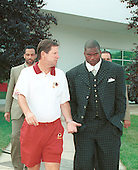 Washington Redskins head coach Norv Turner, front left, escorts linebacker LaVar Arrington (56), center, the Redskins first pick in the first round of the 2000 NFL Draft (second pick overall), front right, out of Penn State University, to speak to the media at Redskin Park in Ashburn, Virginia after agreeing to a 6 year contract with a $10.75 million signing bonus on July 22, 2000.  His agents Kevin Poston, right, and Carl Poston, left, follow behind.  La Var will begin practicing with his teammates tomorrow.  With the last holdout reporting, the Redskins have all of their players under contract. <br /> Credit: Arnie Sachs / CNP