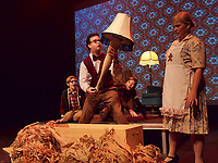 Old Man Parker, played by Nick Campbell, reacts with joy on winning a leg lamp while his wife played by Jennifer Zimmer doesn't like it one bit.  Their kids, Ralphie, far left, played by Ben Adair, and Randy, played by Noah Leonard, get a kick out of the prize.  The leg lamp produces big laughs in Theatre Sarnia's upcoming production of A Christmas Story, The Musical.