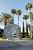 USA, California, San Diego, skateboarder carving a turn off a sculpture on the waterfront near the convention center