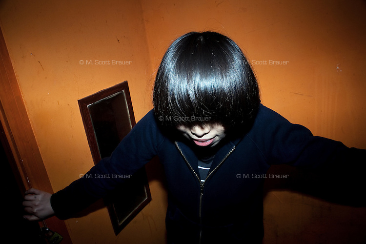 Yi Liu, singer of the Chinese punk band July 16th, poses for a portrait after a gig at Castle Bar in Nanjing, China.