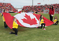 06 April 2013: The young escorts hold the Canadian flag during the national anthems in an MLS game between FC Dallas and Toronto FC at BMO Field in Toronto, Ontario Canada..The game ended in a 2-2 draw..
