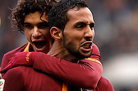 Calcio, Serie A: Roma-Genoa. Roma, stadio Olimpico, 12 gennaio 2014.<br /> AS Roma defender Mehdi Benatia, of Morocco, right, celebrates with teammate Dodo', of Brazil,  after scoring during the Italian Serie A football match between AS Roma and Genoa, at Rome's Olympic stadium, 12 January 2014. <br /> UPDATE IMAGES PRESS/Isabella Bonotto