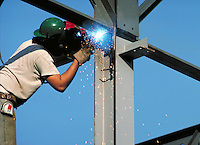 Worker welding steel beams. Huntsville Alabama.