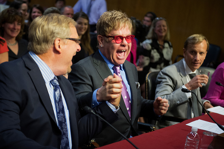 UNITED STATES - MAY 6: From left, Rick Warren, pastor of the Saddleback Church, musician Sir Elton John, founder of the Elton John AIDS Foundation, and Mark Dybul, of the Global Fund to Fight AIDS, Tuberculosis, and Malaria, prepare to testify before a Senate Appropriations State, Foreign Operations and Related Programs Subcommittee hearing in Dirksen Building on global health problems, May 6, 2015. Ambassador-at-Large Deborah L. Birx, M.D., also testified. (Photo By Tom Williams/CQ Roll Call)