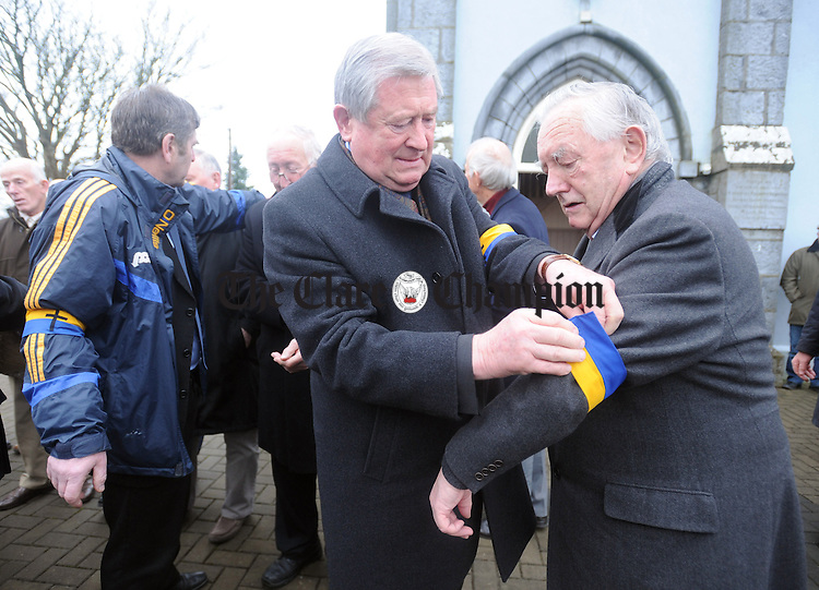 Former hurlers Johnny Cullinane and Harry O' Meara preparing for the guard of honour following the funeral mass of Jimmy Smyth, former Clare hurling star, at St Mary's Church in Ruan. Photograph by Declan Monaghan