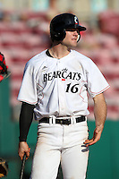 Outfielder Justin Glass #16 of the Cincinnati Bearcats during the Big East-Big Ten Challenge vs. the Ohio State Buckeyes at Al Lang Field in St. Petersburg, Florida;  February 18, 2011.  Cincinnati defeated Ohio State 11-5.  Photo By Mike Janes/Four Seam Images