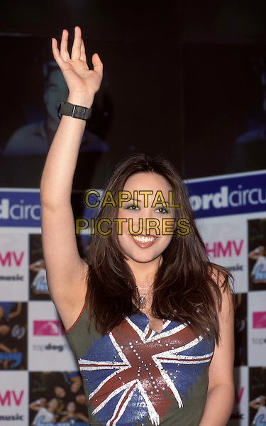 HEARSAY.Ref:10725.popstars, Myleene Klass, waving, armpit, union jack, smiling, half length, half-length.*RAW SCAN - photo will be adjusted for publication*.www.capitalpictures.com.sales@capitalpictures.com.© Capital Pictures