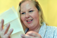 Pictured: Sarah Quick and the letters she found under the floorboards in her house in Pontypridd.<br /> Re: Love letters sent between a young couple over 60 years ago have been found beneath the floorboards of a house by its new owners.<br /> Sarah Quick, 38, was renovating the old cottage that she lives at with her partner and daughter in Pontypridd, south Wales, when she discovered the bundles of letters.<br /> It turned out the letters were sent between a young couple called Rena and John and dated back to the 40s and 50s.<br /> Most of the letters were sent by John who was stationed at RAF stationed in Melksham while Rena was living with her mother in Pontypridd. They tell the tale of a couple at the beginning of a blossoming relationship but separated by circumstances.