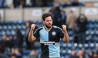 Sam Wood of Wycombe Wanderers punches the air as his team win 1 0 during the Sky Bet League 2 match between Wycombe Wanderers and Bristol Rovers at Adams Park, High Wycombe, England on 27 February 2016. Photo by Andrew Rowland.