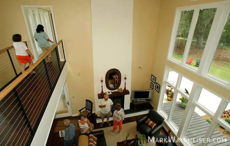 The living room overlooking the lake at the Southern Living Magazine Idea House at St Joe's White Fence Farms six miles east of Tallahassee, Florida June 11, 2006.