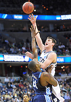 Garrett Butcher of the Monarch shoots over Frank Hassell of the Monarchs. Butler defeated Old Dominion 60-58 during the NCAA tournament at the Verizon Center in Washington, D.C. on Thursday, March 17, 2011. Alan P. Santos/DC Sports Box
