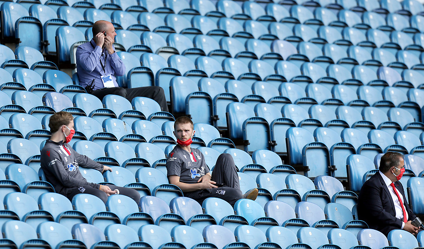 Members of the Nottingham Forest staff observe social distancing rules and were PPE (personal protective equipment) as they sit in empty stands<br /> <br /> Photographer Rich Linley/CameraSport<br /> <br /> The EFL Sky Bet Championship - Sheffield Wednesday v Nottingham Forest - Saturday 20th June 2020 - Hillsborough - Sheffield <br /> <br /> World Copyright © 2020 CameraSport. All rights reserved. 43 Linden Ave. Countesthorpe. Leicester. England. LE8 5PG - Tel: +44 (0) 116 277 4147 - admin@camerasport.com - www.camerasport.com