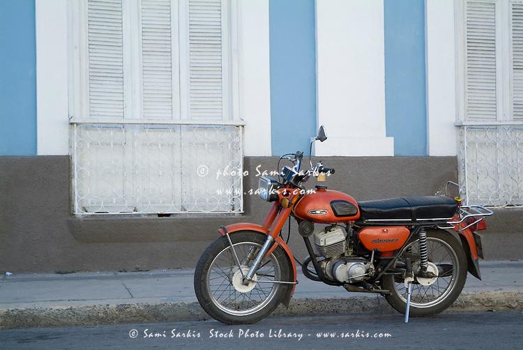 Classic motorbike parked near Parque Jose Marti, Cienfuegos, Cuba.