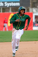 Beloit Snappers shortstop Eric Marinez (2) heads to third base during a Midwest League game against the Peoria Chiefs on April 15, 2017 at Pohlman Field in Beloit, Wisconsin.  Beloit defeated Peoria 12-0. (Brad Krause/Four Seam Images)