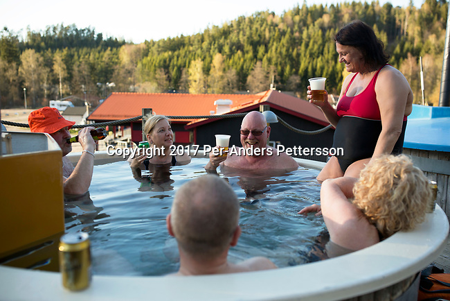ULLARED, SWEDEN - MAY 5: Holidaymakers share a Jacuzzi at a camping on May 5, 2017 in Ullared, Sweden. Ullared is famous for Gekas, Sweden's most famous superstore founded in 1963. The shop and surrounding shops have about five million visitors a year. They also have a camping and a hotel. (Photo by Per-Anders Pettersson/Getty Images)