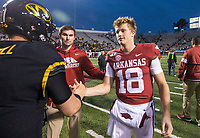Hawgs Illustrated/BEN GOFF <br /> Jack Lindsey (18), Arkansas quarterback, greets Taylor Powell, Missouri quarterback, Saturday, Nov. 29, 2019, after the game at War Memorial Stadium in Little Rock. The two played together at Fayetteville High.