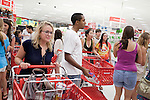 August 20, 2011. Chapel Hill, NC.. UNC students brought to the local Super Target by company chartered buses search the aisles for products. Target hired the buses and staged sales to encourage students to buy items in the store that they might need for their dorm rooms.. Many companies have increased their efforts to reach the youth market by employing popular college students to raise the awareness of the brand by peer to peer marketing on campus' around the country.