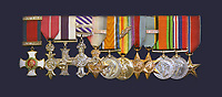 BNPS.,co.uk (01202 558833)<br /> Pic: ColinParr/BNPS<br /> <br /> Lt Col Strange's impressive medal set includes an OBE, DSO, DFC and bar and MC....<br /> <br /> A war hero who was dubbed the 'bravest man in the world' has been remembered after his lost and abandoned grave was re-discovered.<br /> <br /> The family of Lieutenant Colonel Louis Strange held a moving ceremony in a churchyard after his grave was repaired, spruced-up and re-dedicated. <br /> <br /> Lt Col Strange was a highly-decorated aviator pioneer who served in both world wars and cheated death on two occasions 25 years apart.<br /> <br /> He was buried in a village churchyard in Worth Matravers, Dorset, with a simple gravestone that was found leaning over and covered in lichen.