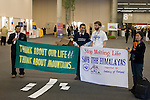 Activists display banners at the entrance to the halls of the Barcelona Climate Talks to remind delegates about the mountains and the pressure they face from climate change. (©Robert vanWaarden ALL RIGHTS RESERVED)
