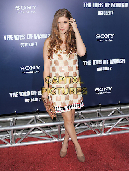 Kate Mara.The L.A. Premiere of 'The Ides of March' held at The Academy of Motion Picture Arts & Sciences  in Beverly Hills, California, USA..September 27th, 2011.full length white beige paillettes sequins sequined dress check brown clutch bag shoes hand arm.CAP/RKE/DVS.©DVS/RockinExposures/Capital Pictures.