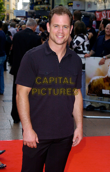 "KIERAN BRACKEN.UK premiere of ""Die Hard 4.0: Live Free or Die Hard"" at the Empire Leicester Square, London, England. .June 20th, 2007.half 3/4 length black top.CAP/CAN.©Can Nguyen/Capital Pictures"