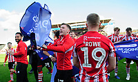 Lincoln City's Shay McCartan celebrate after securing promotion from Sky Bet League Two<br /> <br /> Photographer Chris Vaughan/CameraSport<br /> <br /> The EFL Sky Bet League Two - Lincoln City v Cheltenham Town - Saturday 13th April 2019 - Sincil Bank - Lincoln<br /> <br /> World Copyright &copy; 2019 CameraSport. All rights reserved. 43 Linden Ave. Countesthorpe. Leicester. England. LE8 5PG - Tel: +44 (0) 116 277 4147 - admin@camerasport.com - www.camerasport.com