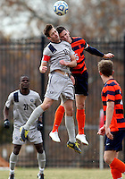 WASHINGTON, DC - NOVEMBER 25, 2012: Steve Neumann (18) of Georgetown University goes up for a header against Ted Cribley (5) of Syracuse University during an NCAA championship third round match at North Kehoe field, in Georgetown, Washington DC on November 25. Georgetown won 2-1 after overtime and penalty kicks.