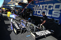 Sept. 22, 2013; Ennis, TX, USA: Crew members work on the car of NHRA top fuel dragster driver Antron Brown during the Fall Nationals at the Texas Motorplex. Mandatory Credit: Mark J. Rebilas-