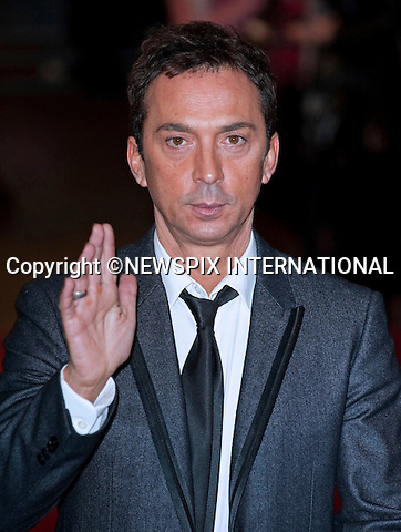 "Bruno Tonioli.World Premiere of NINE.Attended by the all star cast including Daniel Day-Lewis, Penelope Cruz, Dame Judi Dench, Kate Hudson and Nicole Kidman_Odeon Leicester Square_London, 03/12/2009..Mandatory Photo Credit: ©Dias/Newspix International..**ALL FEES PAYABLE TO: ""NEWSPIX INTERNATIONAL""**..PHOTO CREDIT MANDATORY!!: NEWSPIX INTERNATIONAL(Failure to credit will incur a surcharge of 100% of reproduction fees)..IMMEDIATE CONFIRMATION OF USAGE REQUIRED:.Newspix International, 31 Chinnery Hill, Bishop's Stortford, ENGLAND CM23 3PS.Tel:+441279 324672  ; Fax: +441279656877.Mobile:  0777568 1153.e-mail: info@newspixinternational.co.uk"