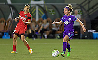 Portland, Oregon - Sunday April 17, 2016: Orlando Pride midfielder/defender Maddy Evans (18) and Portland Thorns FC midfielder Tobin Heath (17). The Portland Thorns play the Orlando Pride during a regular season NWSL match at Providence Park. The Thorns won 2-1.