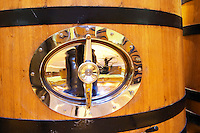 Detail of a wooden fermentation tank vat with a polished stainless steel door, Maison Louis Jadot, Beaune Côte Cote d Or Bourgogne Burgundy Burgundian France French Europe European
