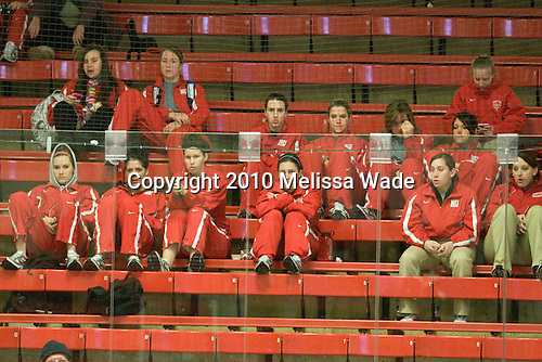 Members of the Boston University Terriers watch the second game. - The Harvard University Crimson defeated the Boston College Eagles 5-0 in their Beanpot semi-final game on Tuesday, February 2, 2010 at the Bright Hockey Center in Cambridge, Massachusetts.