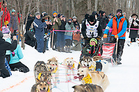 Deke Naaktgeboren and team run past spectators on the bike/ski trail near University Lake with an Iditarider in the basket and a handler during the Anchorage, Alaska ceremonial start on Saturday, March 7 during the 2020 Iditarod race. Photo © 2020 by Ed Bennett/Bennett Images LLC