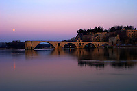The Pont Saint St Benezet bridge in Avignon and the Pope's Palace on the Rhone at sunset with moon, Vaucluse, Rhone, Provence, France