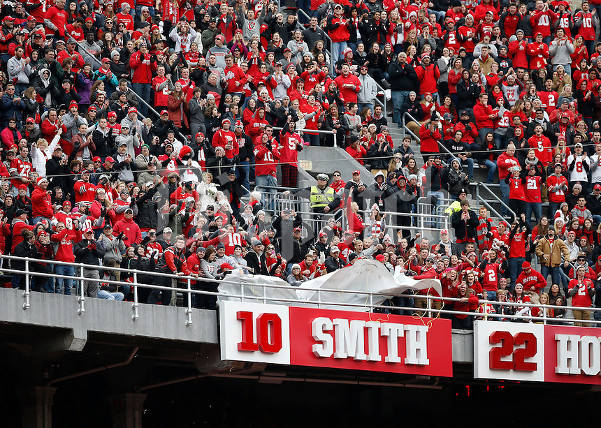 Ohio State fans unveil former quarterback Troy Smith's sign in the Ring of Honor after the 1st quarter of the NCAA football game at Ohio Stadium on Nov. 29, 2014. (Adam Cairns / The Columbus Dispatch)