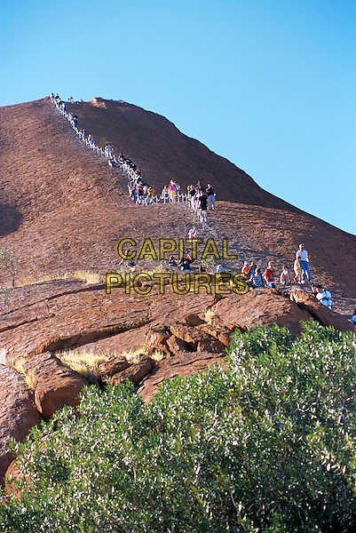 Mount Uluru, Ayers Rock, Kata Tjuta National Park, Northern Territory, Australia. People climbing.