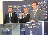 Campbell Ogilvie shows the ball assigned to Alloa Athletic drawn away to Rangers. Scottish FA President Campbell Ogilvie joined by former Rangers and Scotland striker Derek Johnstone and Kristof Fahy, Chief Marketing Officer at William Hill, in conducting the draw for Round 3 of the William Hill Scottish Cup which took place at Hamilton Park Racecourse on 1.10.12