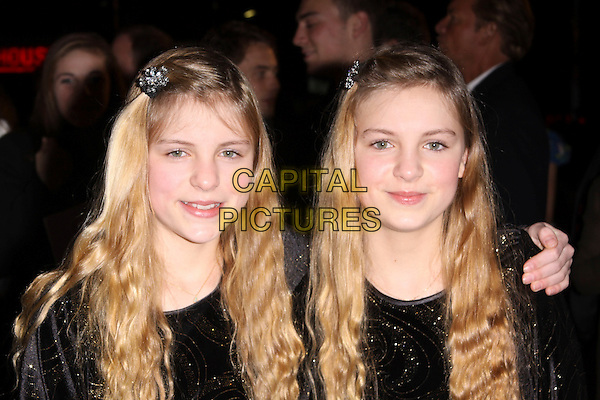"CHLOE & HOLLY MACKIE.The UK Film Premiere of ""St. Trinian's 2: The Legend Of Fritton's Gold"" at Empire Leicester Square, London, England..December 9th 2009.Trinians St arrivals headshot portrait  twins sisters family black.CAP/AH.©Adam Houghton/Capital Pictures."