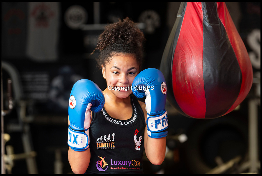 BNPS.co.uk (01202 558833)Pic: RogerArbon/BNPS<br /> <br /> Gabrielle Reid at Primitive Gym in Poole, Dorest.<br /> <br /> An inspiring 14 year old girl with cerebral palsy who was once wheelchair bound has taken part in her boxing match - and she won.Gabrielle Reid was born with right hemiplegia which affects her muscle control and movement making it difficult to walk, let alone spar in the ring.However, since taking up boxing five years ago, her movement and coordination have improved to such an extent that she has just competed in her first bout in her home town of Poole, Dorset.She defeated a fully able bodied fighter in a three round contest and has now set her sights on her second bout, scheduled for October.